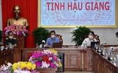 政府副總理武德膽(中)主持會議。(圖源:H. Nguyên)