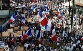 當地時間14日,法國21萬5000人參加遊行活動,反對健康通行證措施,其中巴黎近1萬4000人參與。(圖源:AFP)