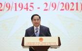政府總理范明政代表黨及國家領導在儀式上致辭。(圖源:越通社)