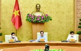 政府總理范明政(中)主持會議。(圖源: VGP)