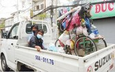 第四郡職能部門宣傳、動員和送流浪者前往各集中單位。