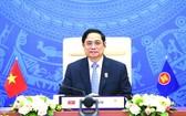 政府總理范明政在會議上致詞。(圖源: 越通社)