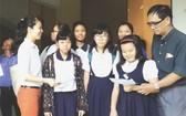 521學生參加華語小學會考。(圖片來源:海韻)