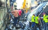 五月二十二日在巴基斯坦卡拉奇拍攝的飛機墜毀現場。