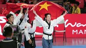Taekwondo Việt Nam thi đấu nội dung quyền sáng tạo đồng đội kết hợp. Ảnh: DŨNG PHƯƠNG
