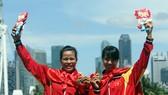 Phạm Thị Huệ (trái) giành vé tham dự Olympic cho rowing Việt Nam.