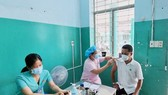 HLV Đặng Anh Đăng của cầu lông TPHCM tiêm vaccine mũi 2.