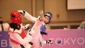 Võ sĩ Trương Thị Kim Tuyền (phải). Ảnh: Liên đoàn Taekwondo thế giới