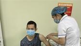 Tay vợt cầu lông Nguyễn Tiến Minh đã hoàn tất tiêm vaccine