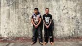 Phan Thái Nguyên và Nguyễn Văn Tuấn bị bắt tạm giam để điều tra về cho vay lãi nặng. Ảnh: HOÀNG DUNG