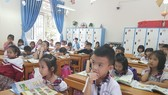 Học sinh Trường Tiểu học Kim Ngọc, TP Vĩnh Yên, tỉnh Vĩnh Phúc học SGK Cánh Diều. Ảnh: PHAN THẢO