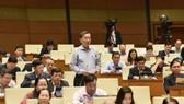 Bộ trưởng Tô Lâm giải trình trước Quốc hội. Ảnh: VIẾT CHUNG