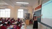 Qui định chức danh nghề nghiệp, xếp lương viên chức giảng dạy trong các cơ sở giáo dục gây nhiều lo lắng cho giáo viên. ẢNH: QUANG PHÚC