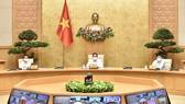 Thủ tướng Phạm Minh Chính chủ trì và phát biểu tại cuộc họp với Ban Chỉ đạo Quốc gia phòng, chống dịch Covid-19, chiều 7-5. Ảnh: VIẾT CHUNG