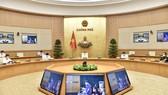 Thủ tướng Phạm Minh Chính triệu tập cuộc họp trực tuyến khẩn cấp với 2 tỉnh Bắc Giang, Bắc Ninh. Ảnh: VIẾT CHUNG