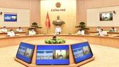 Thủ tướng Phạm Minh Chính chủ trì cuộc họp trực tuyến về việc sản xuất vaccine phòng chống Covid-19 trong nước. Ảnh: VIẾT CHUNG