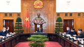 Thủ tướng Phạm Minh Chính  tiếp Đại sứ Liên bang Nga tại Việt Nam Bezdetko tới chào xã giao. Ảnh: VIẾT CHUNG
