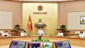 Thủ tướng Phạm Minh Chính chủ trì họp Chính phủ về phòng chống dịch. Ảnh: VIẾT CHUNG