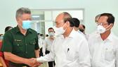 Chủ tịch nước Nguyễn Xuân Phúc tiếp xúc cử tri huyện Hóc Môn. Ảnh: VIỆT DŨNG