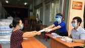 Người dân TPHCM phát tín hiệu cần hỗ trợ để nhận tiền mặt, túi an sinh