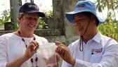 Vietnamese and Australian experts release anti-dengue mosquitoes in Nha Trang (Photo: VNA)