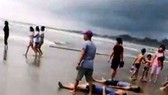 Four killed when big waves sweep 11 people out to sea