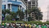 Motorbike taxi drivers in Hanoi (Photo: VNA)
