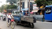 HCMC authorities support poor motorized tricycle drivers to transfer job