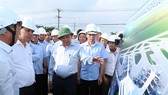 Prime Minister Nguyen Xuan Phuc inspects infrastructure construction at Loc An-Binh Son resettlement area. —VNA/VNS Photo