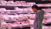 Pork products on shelves. The Ministry of Industry and Trade has founded a group to inspect the pork market to figure out problems that caused failures in cooling domestic pork prices. — VNA/VNS Photo