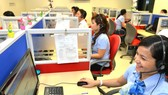 Hotline workers at Ho Chi Minh City Electricity Corporation (EVNHCMC) (Illustrative photo: SGGP)