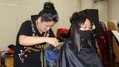 Coronavirus: City barbershops, hair salons reopen at 50 percent capacity