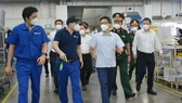 Deputy PM inspects business, production activities in HCMC