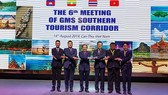 Representatives of four countries posed at the sixth Meeting of Greater Mekong Sub-region (GMS) Southern Tourism Corridor