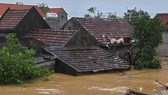 Waist-deep flood inundates houses in Quang Binh Province