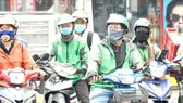 HCMC needs more measures against Covid-19 for app-based motorbike drivers