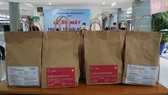 Medical bags support Covid-19 patients treated at home in HCMC
