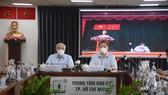 Đồng chí Phan Nguyễn Như Khuê, Trưởng Ban Tuyên giáo Thành ủy TPHCM và đồng chí Dương Anh Đức, Phó Chủ tịch UBND TPHCM chủ trì tại điểm cầu Trung tâm Báo chí TPHCM