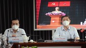 Đồng chí Dương Anh Đức, Phó Chủ tịch UBND TPHCM và đồng chí Lê Văn Minh, Phó Trưởng Ban Thường trực Ban Tuyên giáo Thành ủy TPHCM chủ trì tại điểm cầu Trung tâm Báo chí TPHCM