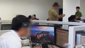 """Lực lượng chức năng khám xét Công ty TNHH Dịch vụ phần mềm Asian Livetech của """"bà trùm"""" Nguyễn Thị Khéo. Ảnh: CQĐT cung cấp."""