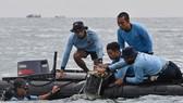 Vụ máy bay rơi tại Indonesia: Tìm thấy nhiều phần thi thể, bắt được tín hiệu hộp đen máy bay