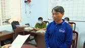 Đối tượng Nguyễn Thành Long vừa bị khởi tố, bắt tạm giam. Ảnh: NGHIÊM TÚC