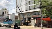 Trung tâm tim mạch - Bệnh viện Đà Nẵng chậm tiến độ vì Vinafor chưa bàn giao mặt bằng số nhà 138 Hải Phòng. Ảnh: NGUYÊN KHÔI