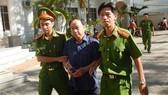 Ông Nguyễn Hữu Hoành, nguyên Phó Giám đốc Chi nhánh Văn phòng Đăng ký đất đai TP Phan Thiết bị khởi tố, bắt tạm giam hôm 7-1.