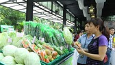 Customers shopping at a supermarket in HCM City. The Government reported yesterday to the National Assembly that the macro economy remains stable. (Photo: VNA/VNS)