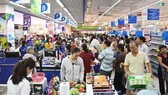 Customers at a Saigon Co.op supermarket in HCMC (Photo: SGGP)