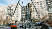 The rubble of the partially collapsed apartment building