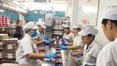 The sausage production line at Vissan Company (Photo: SGGP)