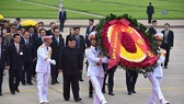DPRK leader Kim Jong-un pays tribute to late Vietnamese President Ho Chi Minh at his mausoleum on March 2 (Photo: SGGP)