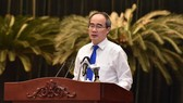 Mr. Nguyen Thien Nhan states at the conference (Photo: SGGP)